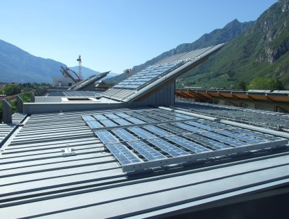 Glass/Tedlar modules (a) mounted on metal frames fixed to the buildings' roof (FAR System Srl)