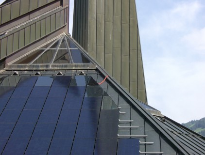Construction phase, the church metal roof and the BIPV mounting system are still visible (Eurac Research)