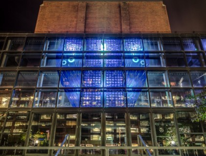 Watermark art installation as part of the west-facing façade of the theatre, backlit with LED lights at night © Sarah Hall